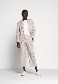 J.CREW - PEYTON PANT IN TRAVELER - Trousers - flax - 1