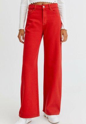 BUNTE  - Široké džíny - red