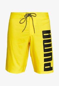 Puma - SWIM MEN LONG BOARD - Swimming shorts - yellow - 3