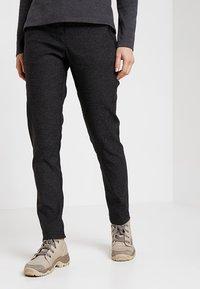 Jack Wolfskin - WINTER TRAVEL PANTS WOMEN - Pantaloni outdoor - black - 0