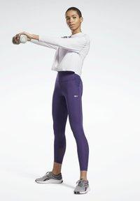 Reebok - LUX SPEEDWICK LEGGINGS - Leggings - purple - 1
