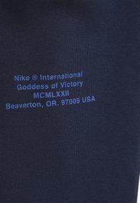 Nike Sportswear - Teplákové kalhoty - midnight navy/white - 2