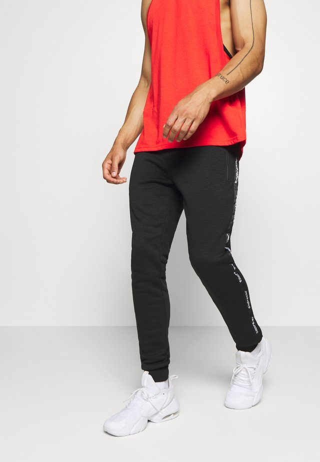 JJIWILL JJTRAIN PANT - Teplákové kalhoty - black