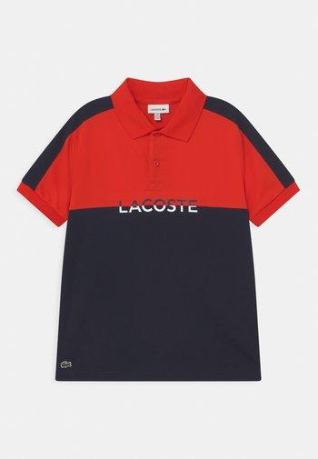 Poloshirts - redcurrant bush/navy blue