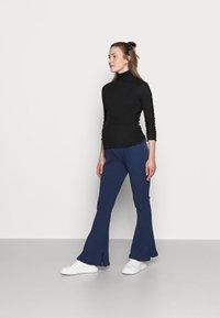 Glamorous Bloom - LADIES FLARES - Spodnie materiałowe - navy - 1