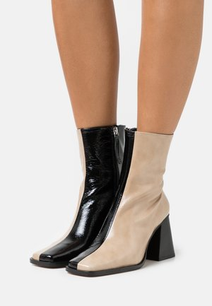 SOUTH - Classic ankle boots - beige