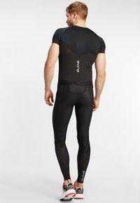 Skins - Base layer - black - 2