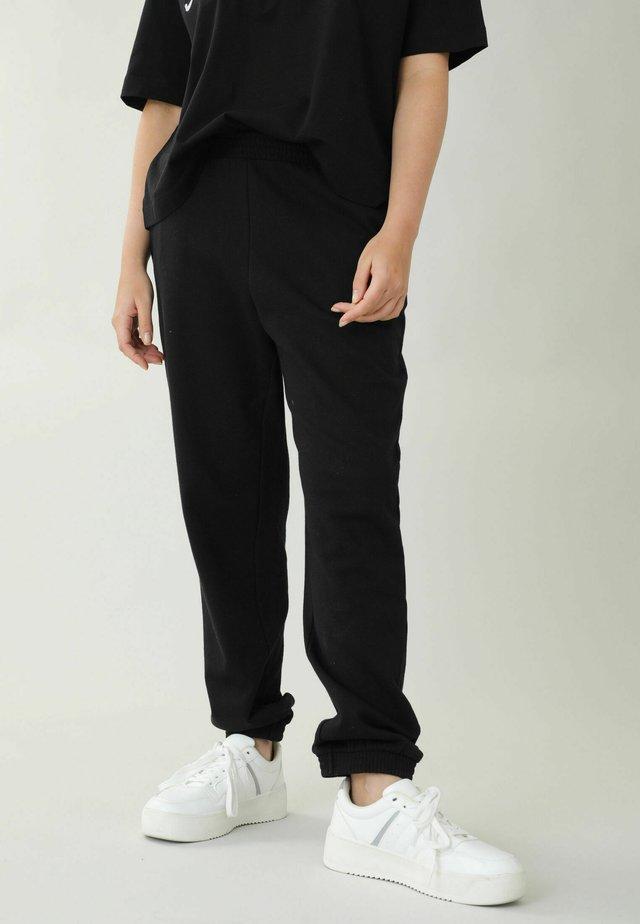 Spodnie treningowe - schwarz