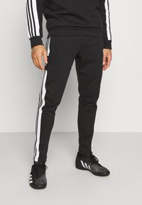 adidas Performance - SQUAD - Tracksuit bottoms - black - 0
