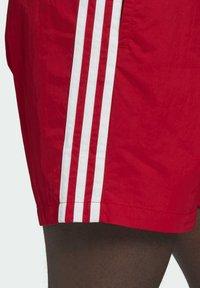adidas Originals - ADICOLOR CLASSICS 3-STRIPES SWIM SHORTS - Swimming shorts - red - 4