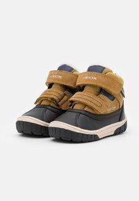 Geox - OMAR BOY WPF - Winter boots - yellow/blue - 1