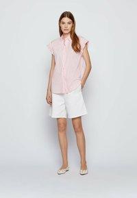 BOSS - BEMIRTA - Button-down blouse - pink - 1