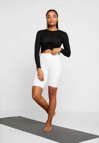 Onzie - TWIRL  - Long sleeved top - black - 1