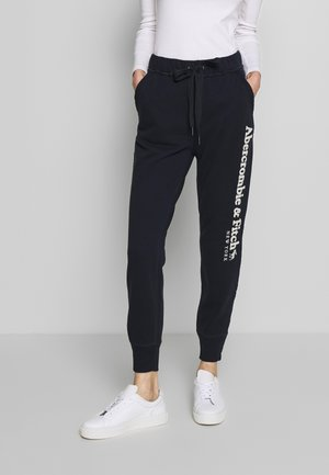 LONG LIFE - Tracksuit bottoms - navy