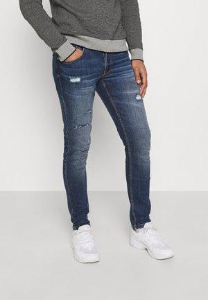 STOCKHOLM DESTROY - Jeans slim fit - island blue