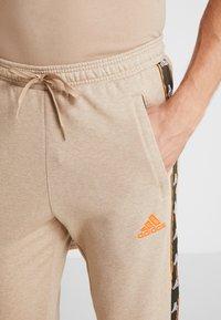 adidas Performance - Pantalones deportivos - tan - 3
