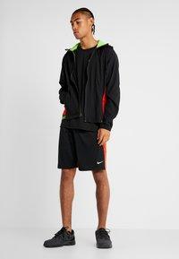 Nike Performance - FLEX - Chaqueta de entrenamiento - black/electric green - 1