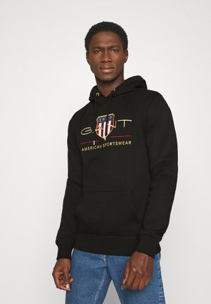 ARCHIVE SHIELD HOODIE - Jersey con capucha - black