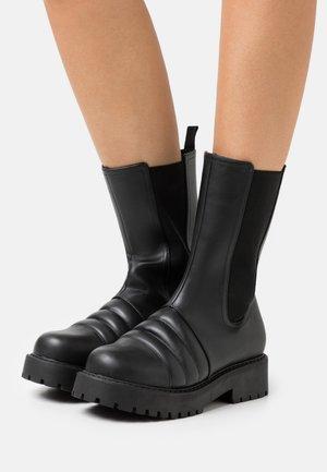 VEGAN UNO BOOT - Platform-saappaat - black