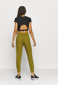 Nike Performance - DRY GET FIT  - Tracksuit bottoms - olive flak - 2