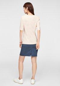 s.Oliver - Print T-shirt - light blush power print - 2