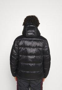 Champion Reverse Weave - HOODED JACKET - Winter jacket - black - 2