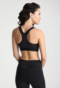 Nike Performance - CLASSIC PAD BRA - Sports bra - black/white - 2