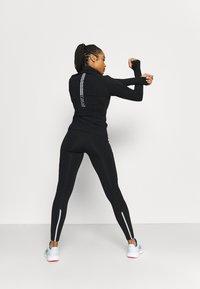 Casall - WINDTHERM JACKET - Sports jacket - black - 1