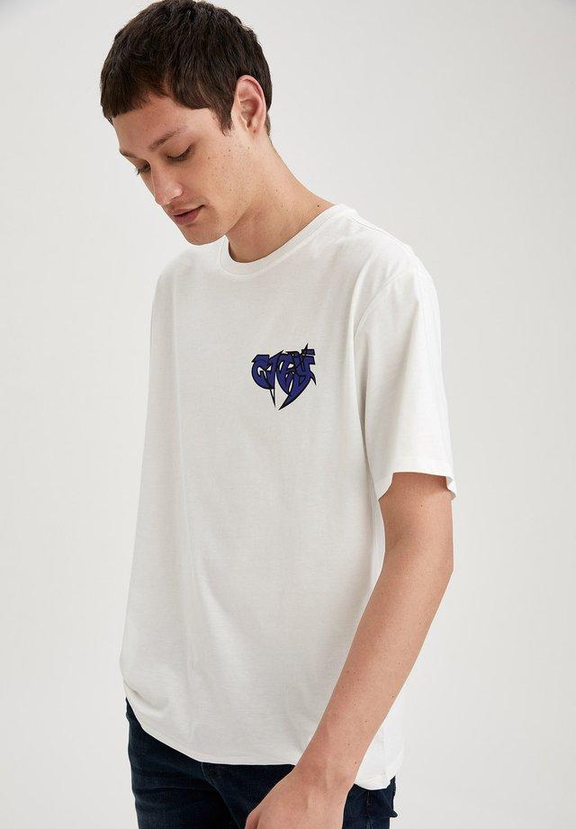 OVERSIZED - T-shirt con stampa - ecru