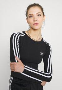adidas Originals - ORIGINALS ADICOLOR BODYWEAR SUIT FITTED - Bluzka z długim rękawem - black - 4