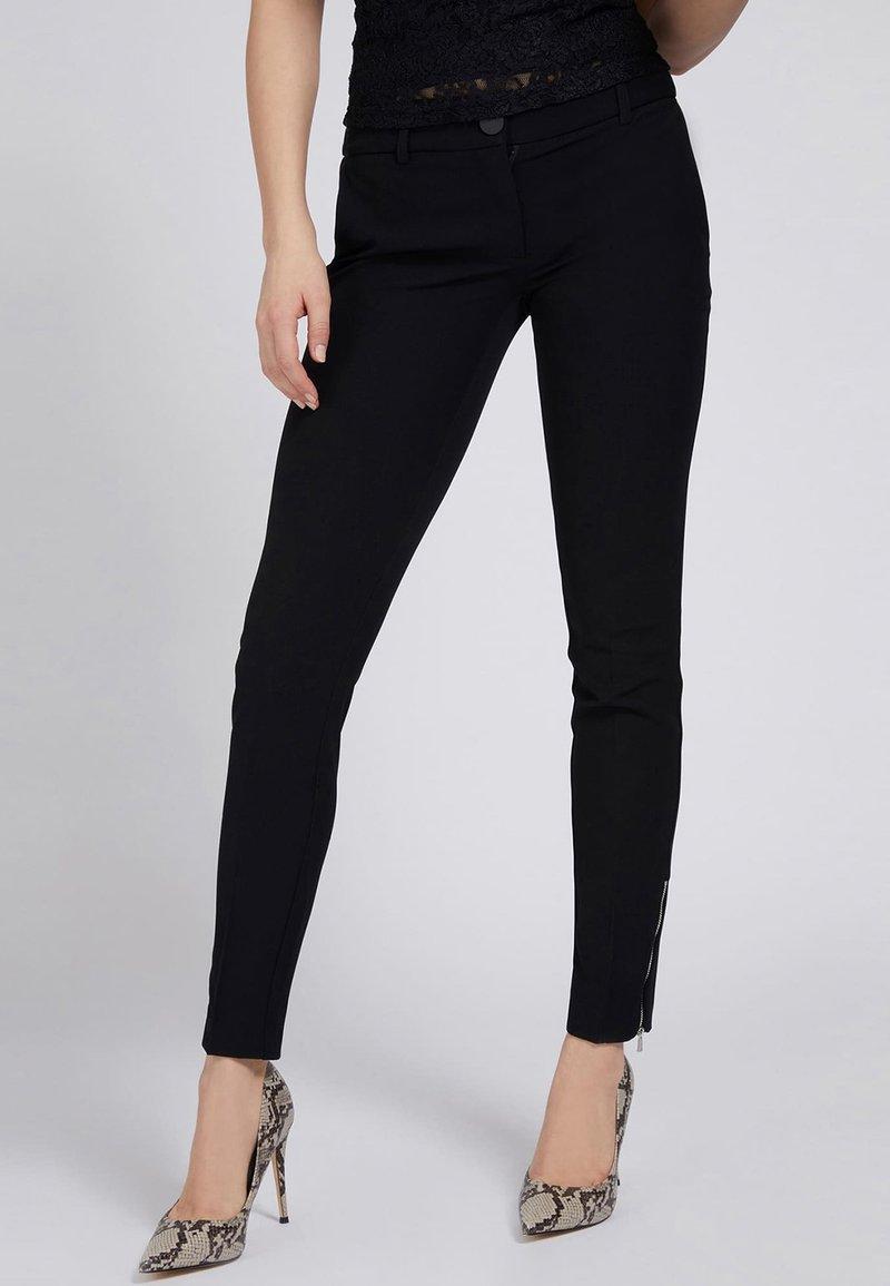 Guess - Trousers - schwarz