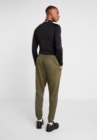 Nike Performance - DRY PANT TAPER - Tracksuit bottoms - cargo khaki/black - 2