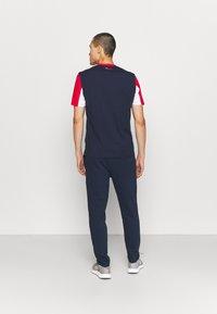 Fila - ORSON PANTS - Teplákové kalhoty - black iris - 2