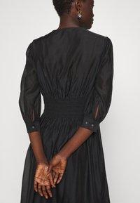 KARL LAGERFELD - DRESS SMOCKING WAIST - Day dress - black - 5