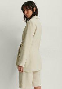 NA-KD - Short coat - beige - 2
