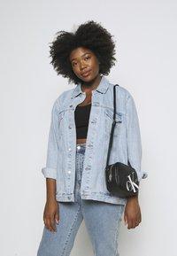 Calvin Klein Jeans - CAMERA BAG - Across body bag - black - 0