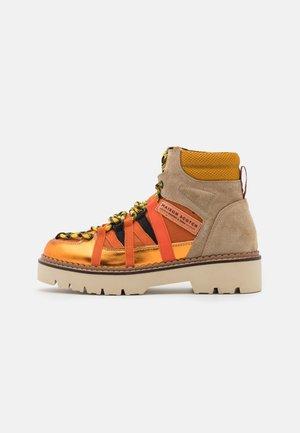 OLIVINE - Platform ankle boots - orange