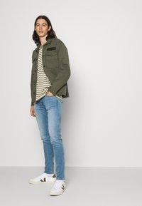 Replay - BRONNY X LITE - Slim fit jeans - medium blue - 3