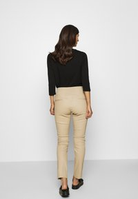 Ibana - COLLETTE - Leather trousers - sand - 2