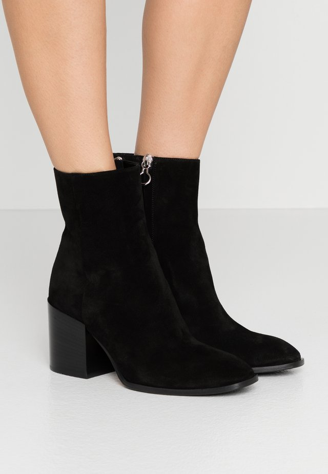 LEANDRA - Classic ankle boots - black