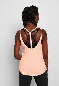 Nike Performance - YOGA STRAPPY TANK - Sportshirt - washed coral - 2