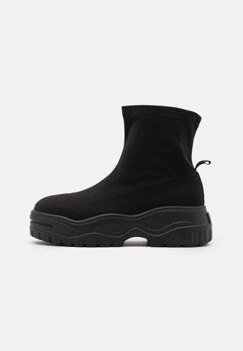 REGINA - Platform ankle boots - black