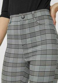 Vero Moda - KARO - Trousers - black - 3