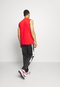 Champion - LEGACY PANTS - Pantalon de survêtement - black - 2