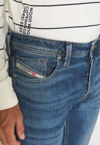 Diesel - LARKEE-X - Straight leg jeans - indigo - 4