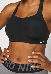 Nike Performance - ALPHA BRA - High support sports bra - black/white - 5