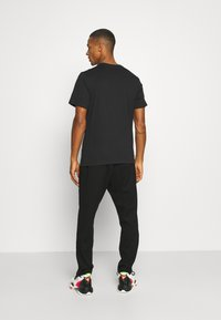 Jordan - JUMPMAN FILL CREW - T-shirt con stampa - black/white - 2
