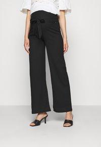 LOVE2WAIT - PANTS CRINCLE - Trousers - black - 0