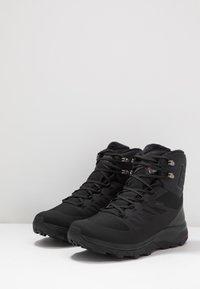 Salomon - OUTBLAST TS CSWP - Winter boots - black - 2