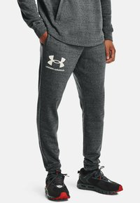 Under Armour - RIVAL TERRY  - Tracksuit bottoms - pitch gray full heather - 0